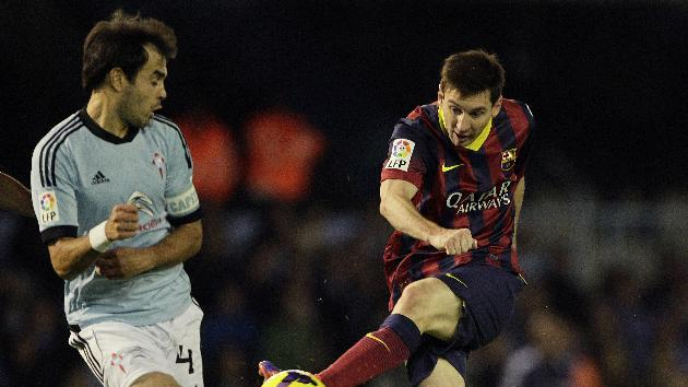 RC Celta's Borja Oubina, left, fights for the ball with FC Barcelona's Lionel Messi from Argentina, right, during a Spanish La Liga soccer match at the Balaidos stadium in Vigo, Spain, Tuesday, Oct. 29, 2013