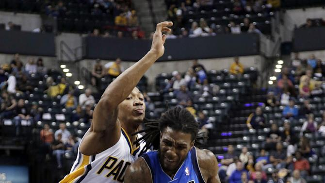 Dallas Mavericks forward Jae Crowder, right, drives around Indiana Pacers guard Orlando Johnson during the first half of an NBA preseason basketball game in Indianapolis, Wednesday, Oct. 16, 2013. The Mavericks won 92-85