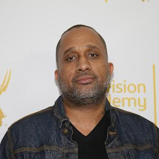 "FILE - In this Jan. 28, 2015 file photo, Creator and Executive producer of ""Black-ish,"" Kenya Barris, poses on the red carpet at ""An Evening with Norman Lear,"" presented by the Television Academy at the Montalban Theatre in the Hollywood section of Los Angeles. Barris is set to write the screenplay for a ""Good Times"" film based on the hit '70s sitcom, his manager confirmed Monday, April 26, 2015, to The Associated Press. ""Good Times,"" which aired on CBS from 1974 to 1979, was about an African-American family living in a poor neighborhood in Chicago. (Danny Moloshok/Television Academy via AP, File)"