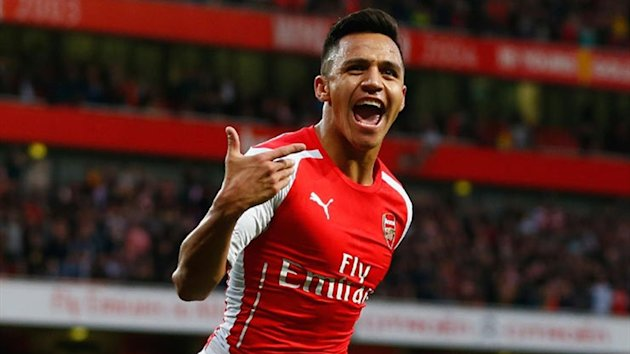 Alexis Sanchez of Arsenal celebrates scoring the first goal for Arsenal during the Barclays Premier League match between Arsenal and Burnley