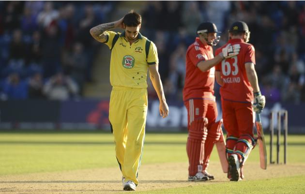 Australia's Mitchell Johnson reacts after a six by England's Jos Buttler in the final over during the fourth one-day international at Sophia Gardens in Cardiff