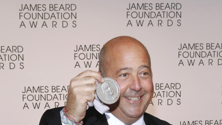 TV personality Andrew Zimmern arrives for the James Beard Foundation Awards, Monday, May 7, 2012, in New York. (AP Photo/Jason DeCrow)