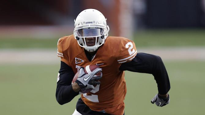 2 Texas football players charged with sex assault