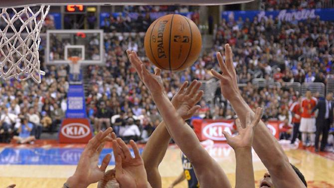 Los Angeles Clippers guard Willie Green, left, battles for a rebound with Utah Jazz center Rudy Gobert, second from left, of France, guard Alec Burks, center, Los Angeles Clippers forward Jared Dudley second from right, and Utah Jazz center Enes Kanter, of Turkey, during the second half of an NBA basketball game, Saturday, Feb. 1, 2014, in Los Angeles