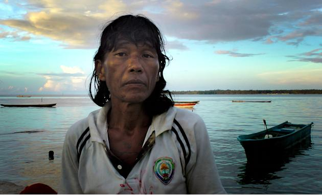 This Friday, Nov. 28, 2014 image shows Ngwe Thein, 42, who has been living on an island near Benjina, Indonesia for three years, after being forced to work on a fishing trawler with inadequate food an