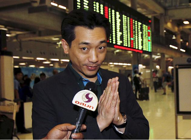 File photo of Thai businessman Taechaubol gesturing as he arrives at Bangkok's Suvarnabhumi Airport