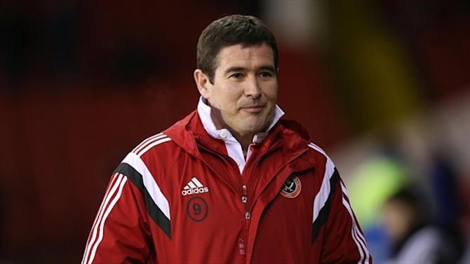 Football - Clough hails Blades display
