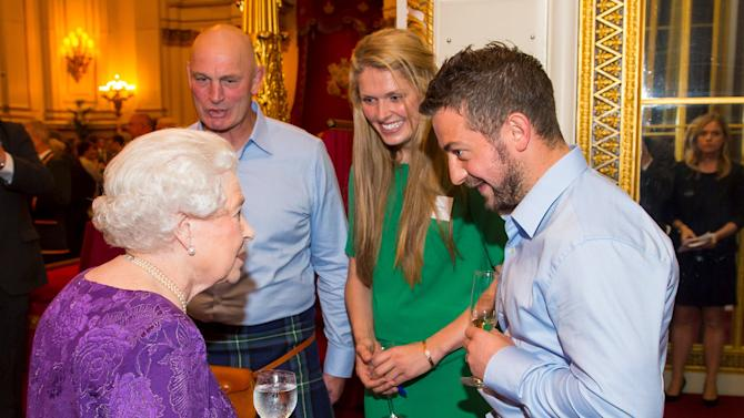 Britain's Queen Elizabeth speaks with Vern Cotter, Fran Leighton and Greig Laidlaw at a Rugby World Cup reception at Buckingham Palace