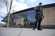 """A heavily-armed police officer walks outside the Trenton train station where some of the 1,000 lobbyists, business owners and politicians are boarding a train to Washington, D.C., Thursday, Feb. 16, 2017 in Trenton, N.J. The state Chamber of Commerce's 80th annual trip — nicknamed the """"Walk to Washington"""" because rail riders generally pace the train's corridors schmoozing and handing out business cards — comes after a national election that hinged in part on repudiating insiders and establishment politics. (AP Photo/Mel Evans)"""