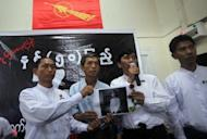 Myanmar's Generation '88 student leaders Ko Ko Gyi (L) and Min Ko Naing (2nd R) hold a picture of student Phyo Phyo Aung (C) speak to the media at the Generation '88 office in Yangon. Authorities have freed all of the student leaders detained in the country's biggest crackdown on activists since the dissolution of the junta