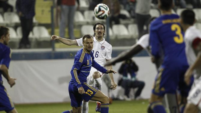 Kljestan of the U.S.passes the ball over Ukraine's Shevchuk during their international friendly soccer match in Larnaca