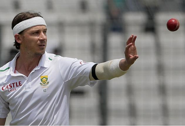 South Africa's Dale Steyn cups his hand to take the ball as he prepares to start his run to deliver the bowl during their first day of the second cricket test match against Bangladesh in Dhaka, Bangla