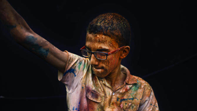 """In this Saturday, April 6, 2013 photo, An Egyptian youth dances during a """"Mahraganat"""" Arabic word for """"festivals,"""" concert by music singers, in Cairo, Egypt. A new musical sound emerged from the underground in Egypt since the country's 2011 revolution, a rapid-fire electronic beat, mixed with hypnotic rhythms drawn from religious festivals and fired up with auto-tuned vocals. Besides getting club crowds dancing all night long, it has given a rebellious voice to long marginalized youth, telling stories of everyday life in beaten-down neighborhoods of Cairo. (AP Photo/Nariman El-Mofty)"""