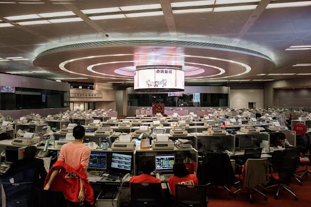 The Hong Kong Stock Exchange and Shanghai market are leading a broad Asian sell-off after China set tepid 2015 economic and trade growth targets