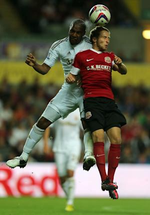 Jordan Clark, pictured right in action against Swansea in the Capital One Cup this season, has penned a new deal at Barnsley