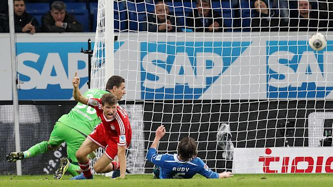 Bayern's Thomas Mueller, left, celebrates when scoring his side's 2nd goal during a German first division Bundesliga soccer match between TSG 1899 Hoffenheim and Bayern Munich in Sinsheim, Germany, Saturday, Nov.2, 2013