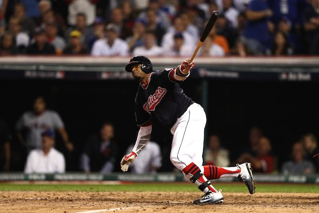CLEVELAND, OH - NOVEMBER 02: Rajai Davis #20 of the Cleveland Indians hits a two-run home run during the eighth inning to tie the game 6-6 against the Chicago Cubs in Game Seven of the 2016 World Series at Progressive Field on November 2, 2016 in Cleveland, Ohio. (Photo by Elsa/Getty Images)