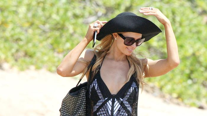 Paris Hilton spends a day with boyfriend River Viiperi on the beach in Hawaii