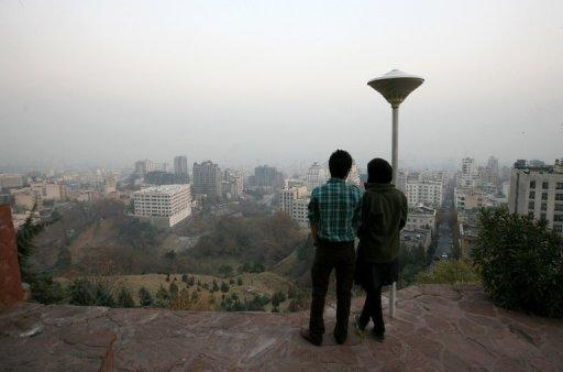 A couple stand at a viewpoint in the north of Tehran on Monday overlooking the city covered in smog. Schools, universities and government agencies in Tehran will be closed on Tuesday and Wednesday due to pollution, the province's governor Morteza Tamadon said on state television