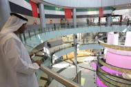 An Emirati man stands in the Dubai Mall in the oil-rich Gulf emirate. Among new attractions in a mega development plan in Dubai is a mall touted to be the largest in the world, not far from what is already the world's largest shopping and entertainment destination, the Dubai Mall.