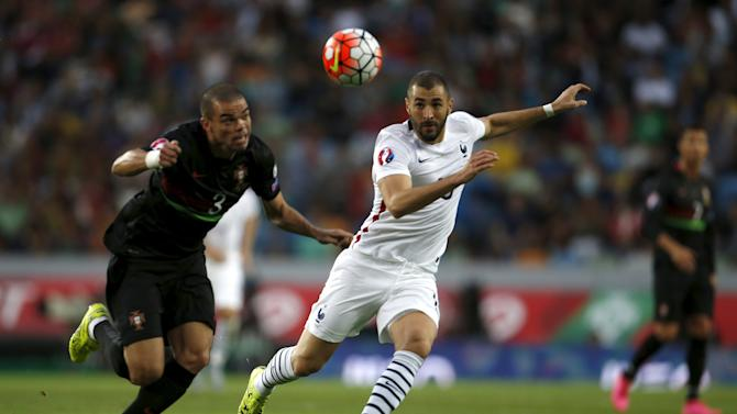 France's Karim Benzema fights for the ball with Portugal's Pepe during their friendly soccer match at Alvalade stadium in Lisbon