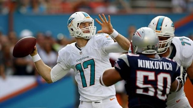 Miami Dolphins quarterback Ryan Tannehill (17) passes the ball as tackle Tyson Clabo (77) blocks New England Patriots defensive end Rob Ninkovich (50) in the second quarter at Sun Life Stadium (Reuters)