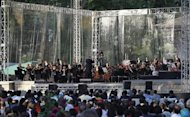 Bavarian State Orchestra and renowned conductor Zubin Mehta (C) performs during the Ehasas-e-Kashmir concert at Shalimar Garden on the outskirts of Srinagar September 7, 2013. REUTERS/Danish Ismail