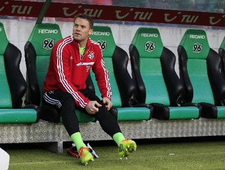 Bayern goalkeeper Manuel Neuer sits on the substitute bench during the German first division Bundesliga soccer match between Hannover 96 and Bayern Munich in Hannover, Germany, Sunday, Feb. 23, 2014