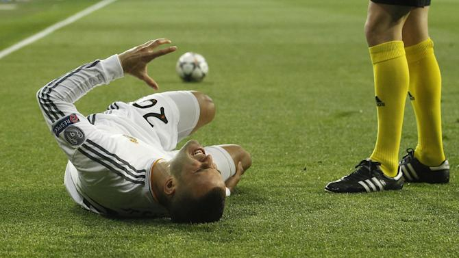 Real's Jese Rodriguez cries out in pain after getting injured during a Champions League last 16 second leg soccer match between Real Madrid and Schalke 04 at the Santiago Bernabeu stadium in Madrid, Spain, Tuesday March 18, 2014