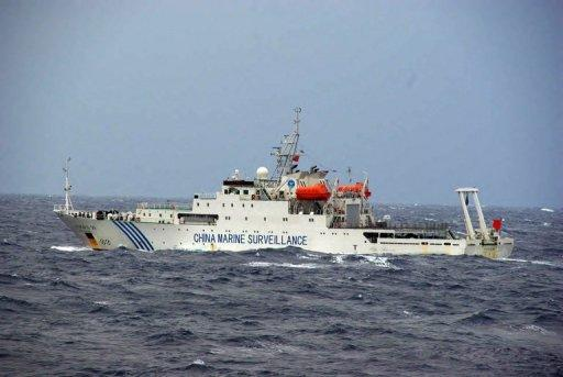 This file photo, taken by Japan Coast Guard, shows a Chinese maritime surveillance ship cruising near a group of disputed islands known as the Senkaku in Japan and the Diaoyu in China, in the East China Sea, on November 27, 2012. Three Chinese state-owned ships entered the waters again on Friday, in the first intrusion since a new government was elected in Tokyo.