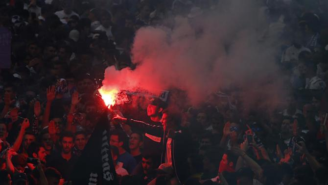 Real Madrid fans outside the stadium before the game with flares