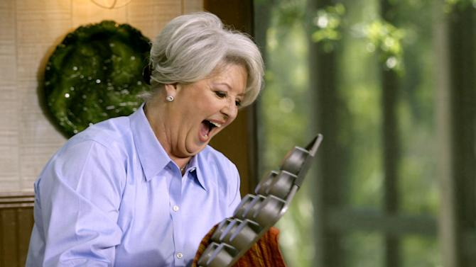 FILE - This 2006 file photo originally released by the Food Network shows celebrity chef Paula Dean. Paula Deen's fans are serving up deep-fried outrage to the Food Network for its decision to dump the Southern comfort food queen after she acknowledged using racial slurs in the past. (AP Photo/ Food Network, file)