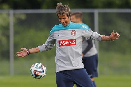 Portugal's national soccer team player Fabio Coentrao warms up for a training session in Foxborough