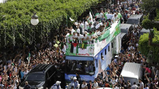 Algeria's soccer players are welcomed by fans in downtown Algiers, after returning from the 2014 World Cup soccer tournament