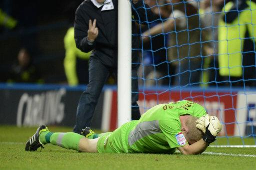 Chris Kirkland lies on the ground after being struck by a Leeds United fan