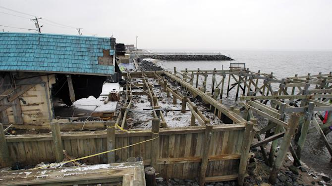 "Heavily damaged by Superstrom Sandy, Jakeabob's Bay restaurant and piers are seen Tuesday, Feb. 5, 2013, in Union Beach, N.J. New Jersey Gov. Christie told a gathering in Union Beach Tuesday that the National Flood Insurance Program's handling of claims in New Jersey ""has stunk,"" complaining that the program has been far too slow to resolve claims from Superstorm Sandy, with 70 percent of cases unresolved three months after the disaster. (AP Photo/Mel Evans)"