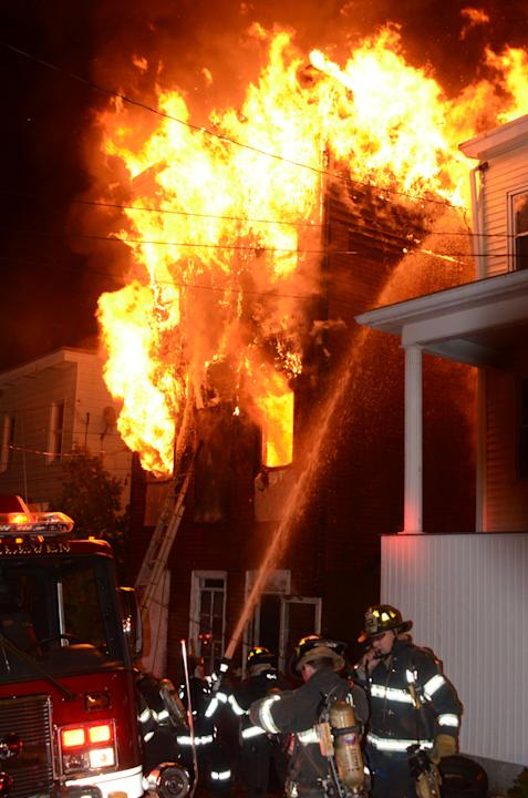 Firefighters battle an early-morning house fire that killed four children and two adults in Pottsville, Pa., Monday, May 13, 2013. The blaze broke out around 11:55 p.m. Sunday at the single-family hom