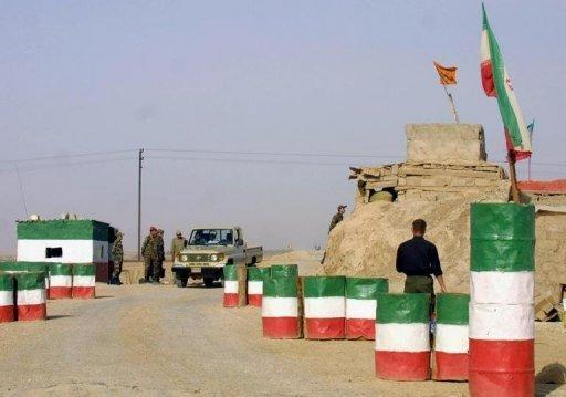 A car passes an Iranian Revolutionary Guard checkpoint on the road between Ahvaz and Khoramshahr. Iran plans to relocate an airport in the southwest of the country after discovering oil deposits under its runway, media reported on Saturday