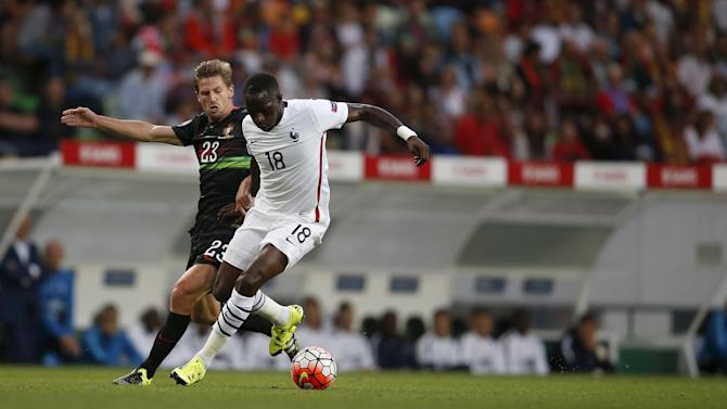 France's Moussa Sissoko fights for the ball with Portugal's Adrien Silva during their friendly soccer match at Alvalade stadium in Lisbon