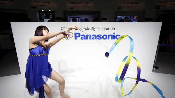 File photo of woman performing rhythmic gymnastics with a ribbon at the Panasonic Corp booth at CEATEC JAPAN 2014 in Chiba