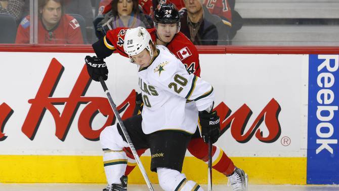 Dallas Stars' Eakin and Calgary Flames Hudler battle for the puck during their NHL hockey game in Calgary.