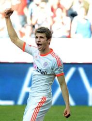 Bayern Munich's midfielder Thomas Mueller celebrates after the second goal for Munich during their German first division Bundesliga football match against VfB Stuttgart in Munich. Bayern Munich won the match 2-0