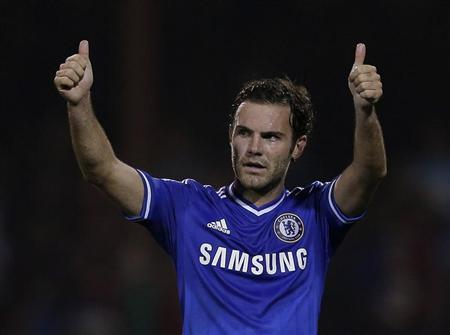 Chelsea's Mata acknowledges the fans after winning their game against Swindon Town in their English League Cup soccer match at the County Ground in Swindon