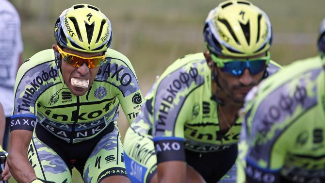 Tinkoff-Saxo rider Contador of Spain eats while cycling during the third stage of the 102nd Tour de France cycling race from Anvers to Huy