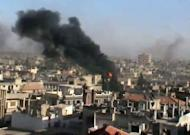 "A YouTube image grab shows smoke billowing from the flashpoint Syrian city of Homs which activists said was being attacked by regime forces. Syrian troops have tortured children, executed them and used children as young as eight as ""human shields"" during military raids against rebels, according to a UN report released Tuesday"