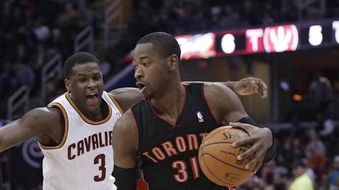 Toronto Raptors' Terrence Ross (31) drives past Cleveland Cavaliers' Dion Waiters (3) during the second quarter of an NBA basketball game Tuesday, March 25, 2014, in Cleveland