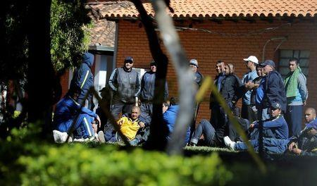 Detained fans of Boca Juniors football club are pictured at the headquarters of the Special Operations Forces of the Paraguayan Police in Asuncion