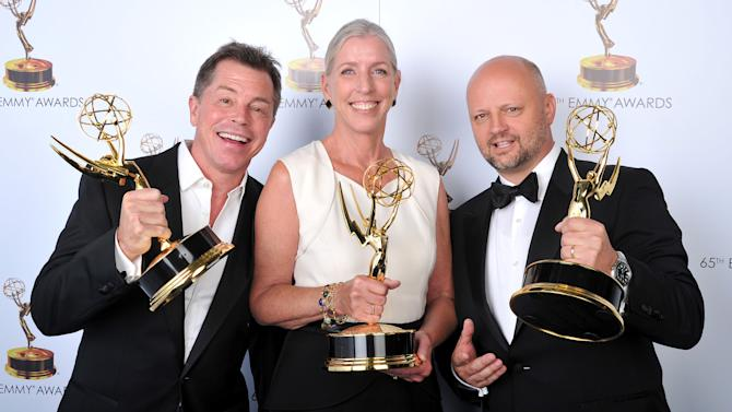 From left, Howard Cummings, Barbara Munch-Cameron, and Patrick Sullivan pose for a portrait at the 2013 Primetime Creative Arts Emmy Awards, on Sunday, September 15, 2013 at Nokia Theatre L.A. Live, in Los Angeles, Calif. (Photo by Vince Bucci/Invision for Academy of Television Arts & Sciences/AP Images)
