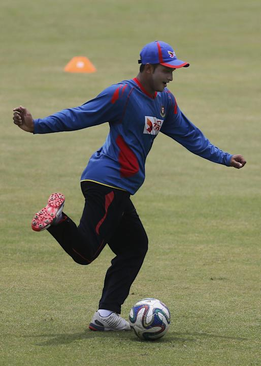 Bangladesh's Shakib Al Hasan plays with a soccer ball during a practice session on the eve of the first Twenty20 match against South Africa in Dhaka, Bangladesh, Saturday, July 4, 2015. Bangladesh and