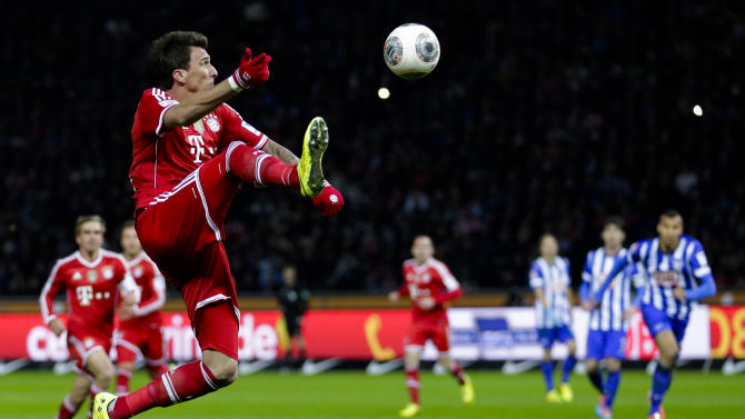 Bayern's Mario Mandzukic of Croatia plays the ball during the first division Bundesliga soccer match between Hertha BSC and FC Bayern Munich in Berlin, Tuesday, March 25, 2014. (AP Photo/Markus Schreiber)